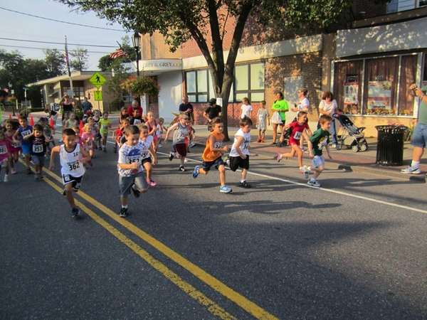 The children's race began Saturday morning on Main