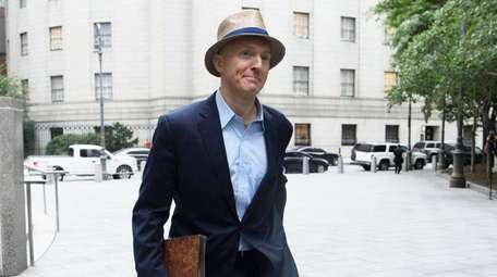 Carter Page exits a federal courthouse in Manhattan