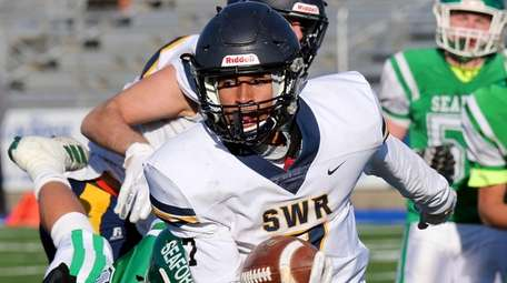Shoreham-Wading River quarterback Xavier Arline against Seaford in