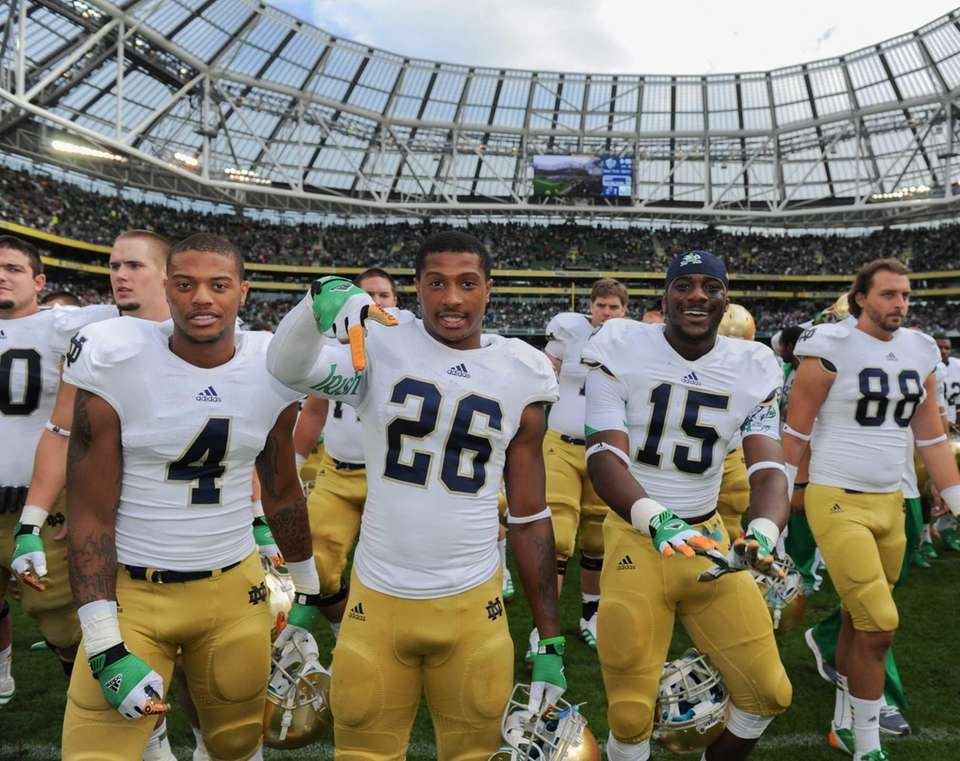 Notre Dame players celebrate after defeating Navy at
