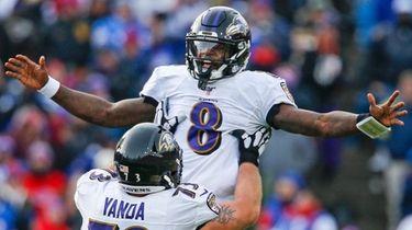 Ravens quarterback Lamar Jackson celebrates a 61-yard touchdown
