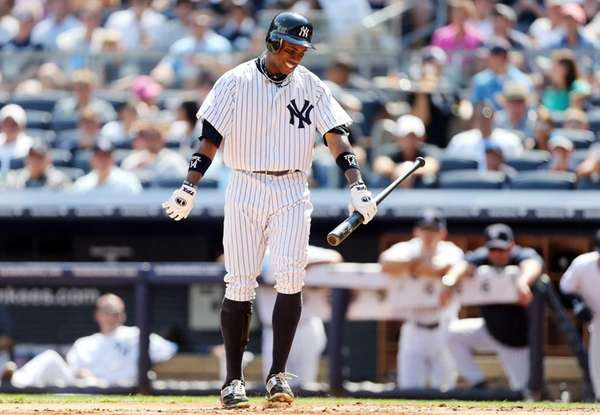 Curtis Granderson reacts after striking out in the