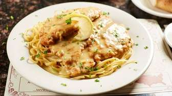 Chicken Francese features gently breaded breast meat in