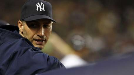 Andy Pettitte sits in the dugout against the