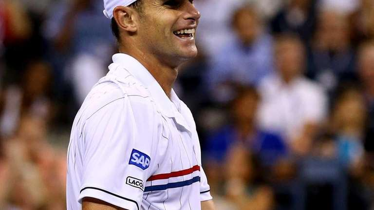 Andy Roddick celebrates match point during his men's