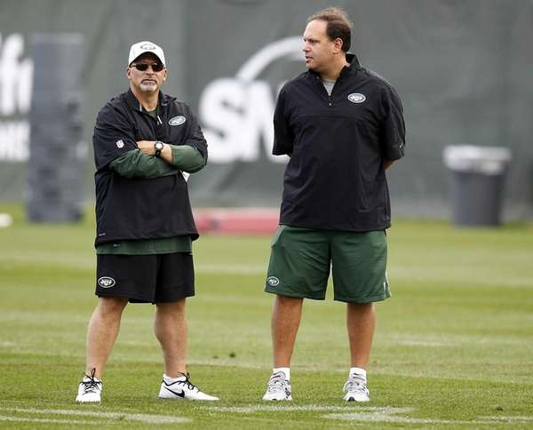 General manager Mike Tannenbaum (right) talks with Tony