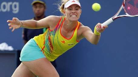Angelique Kerber hits a running forehand return against
