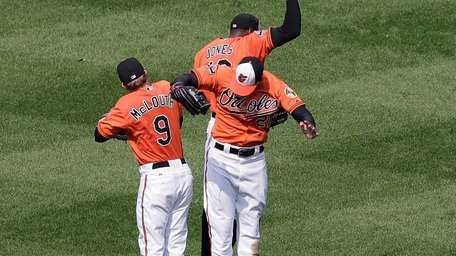 Baltimore Orioles outfielders Nate McLouth, Adam Jones and
