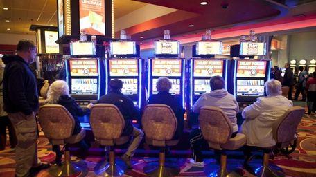 Guests play slot machines at the new Resorts