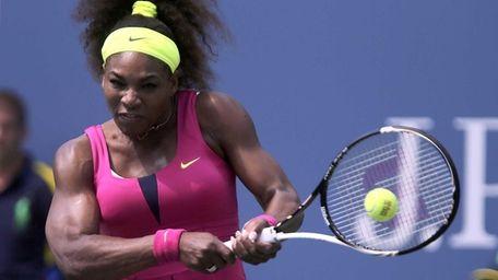 Serena Williams hits a backhand return against Ekatarina