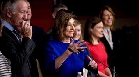 House Speaker Nancy Pelosi of Calif., accompanied by