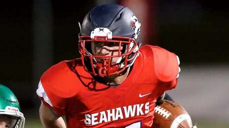 Cold Spring Harbor RB Jacob Bruno breaks the