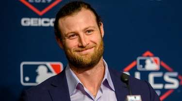 Gerrit Cole speaks to the media at a
