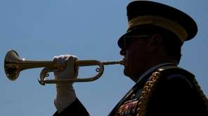 Bugler Lou DiLeo plays