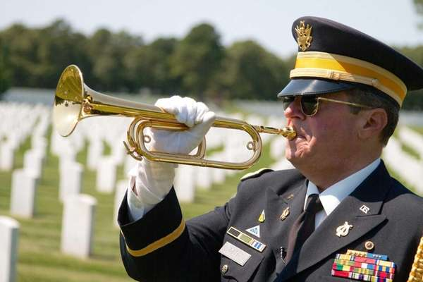 Bugler Lou DiLeo plays taps at Calverton National