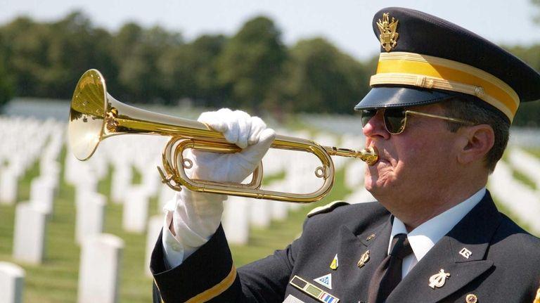 Bugler Lou DiLeo plays taps at Calverton National