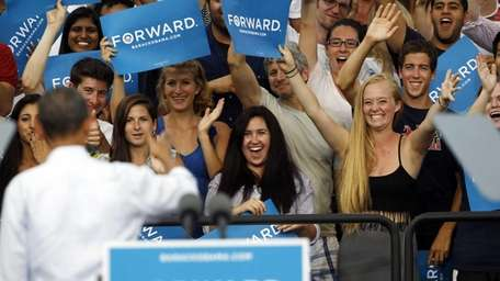 Supporters cheer for President Barack Obama after his