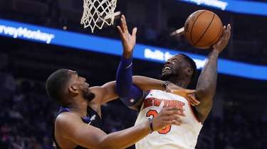 New York Knicks' Julius Randle, right, shoots against