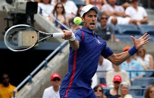 Serbia's Novak Djokovic returns a shot to Julien