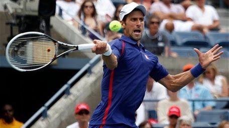 Serbia's Novak Djokovic returns a shot to Julien