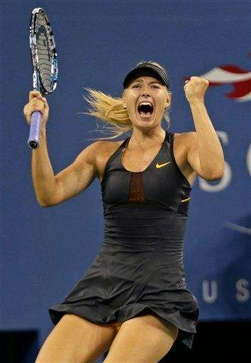 Maria Sharapova of Russia raises her fist after