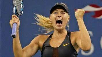 Maria Sharapova of Russia raises her fist after