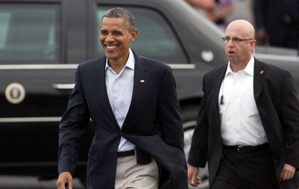 President Barack Obama walks over to greet supporters