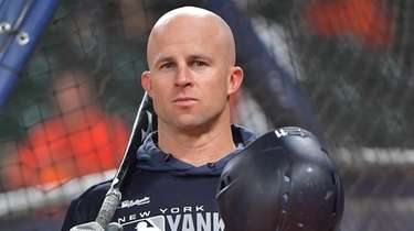 Yankees leftfielder Brett Gardner looks on during batting