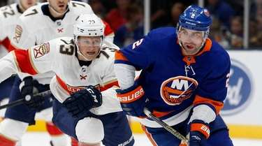 Nick Leddy of the Islanders skates against Dryden