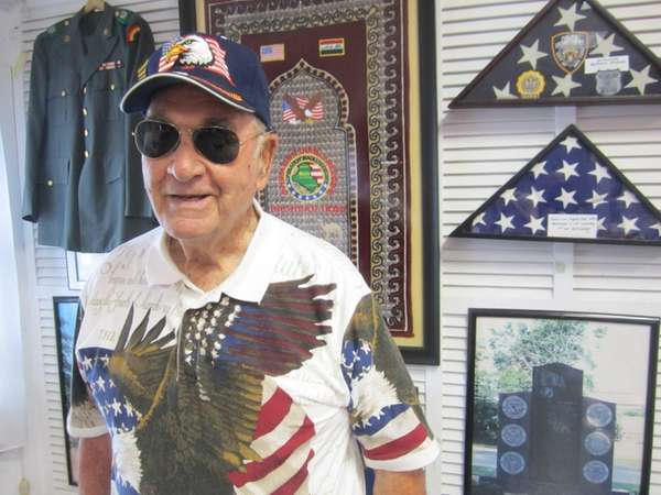 Robert C. Wieboldt, 92, of Levittown, attends the