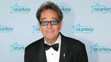 Huey Lewis walks the red carpet at the