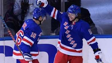 Rangers left wing Artemi Panarin, right, celebrates his