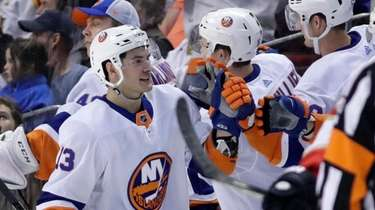 Islanders center Mathew Barzal (13) is congratulated after