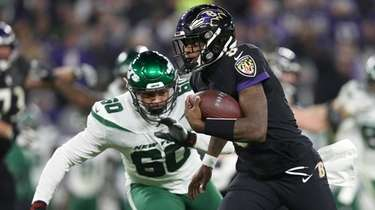 Quarterback Lamar Jackson #8 of the Baltimore Ravens