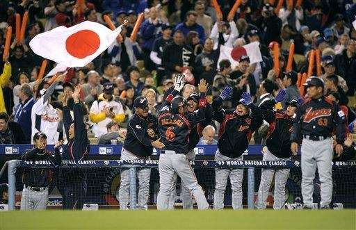 Japan celebrates on the field after beating South