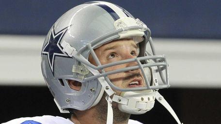 Dallas Cowboys quarterback Tony Romo takes the field