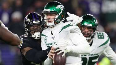 Jets quarterback Sam Darnold fumbles on a hit