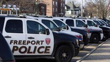 Patrol cars are parked outside Village of Freeport