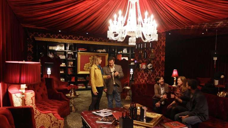 Patrons taste wine in the Red Room at