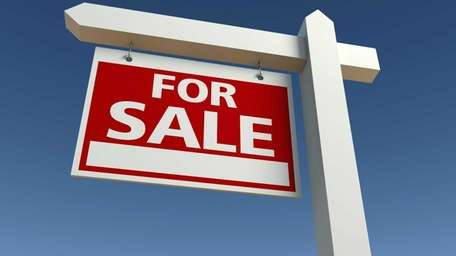 Long Island home prices slipped despite a steady