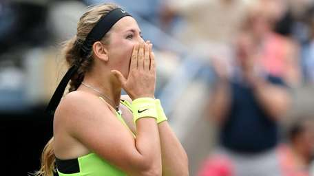 Victoria Azarenka of Belarus celebrates after defeating Samantha