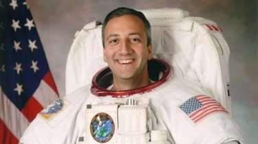 Long Island-raised astronaut Mike Massimino flew on two