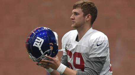 Giants long snapper Colin Holba puts on his