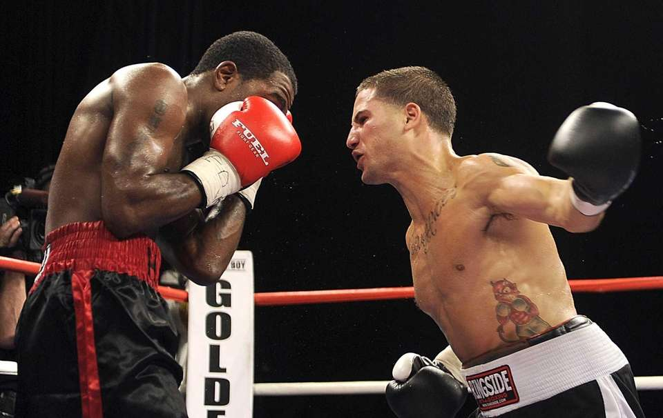 Long Island fighter Michael Brooks, right, lunges with