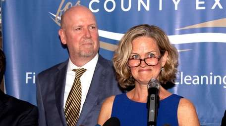 John Curran appears with his wife, now-Nassau County