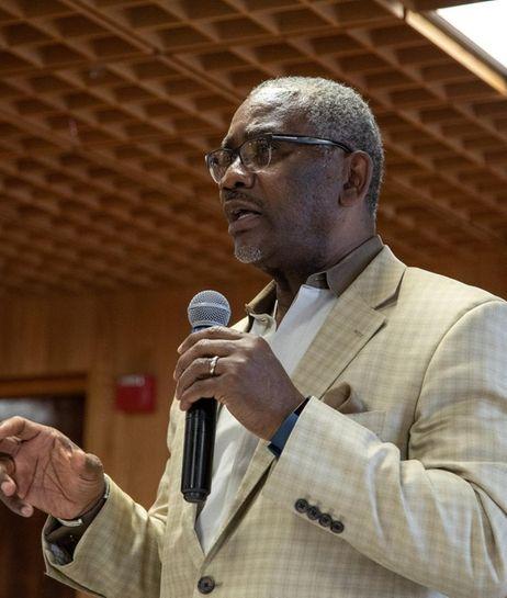 Rep. Greg Meeks speaks at a community meeting