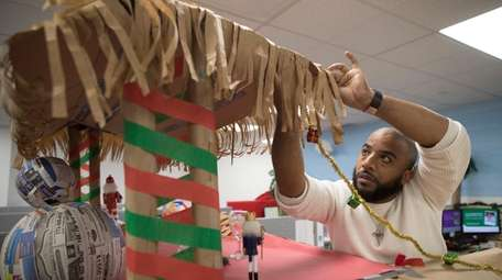 Omar Lesperance of Elmont decorates part of the