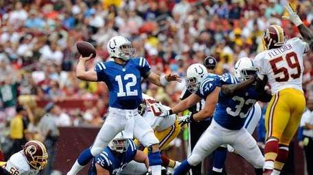 Andrew Luck #12 of the Colts throws a