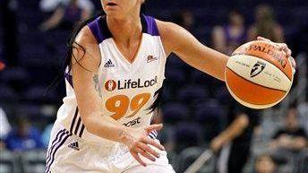 The Phoenix Mercury's Samantha Prahalis dribbles against the