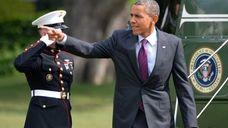 President Barack Obama points toward a crowd of